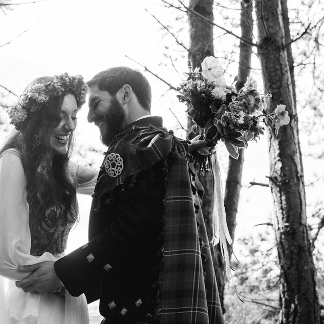 Boho style wedding gown with vintage redesigned waistcoat.