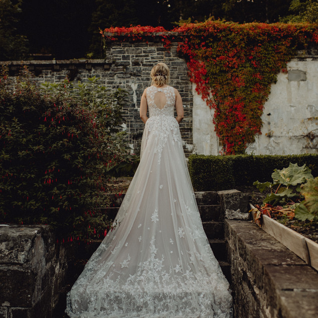 Bespoke Wedding Dress - Starry embroidery with soft dreamy tulle and twinkly glitter layered skirt in a walled garden.