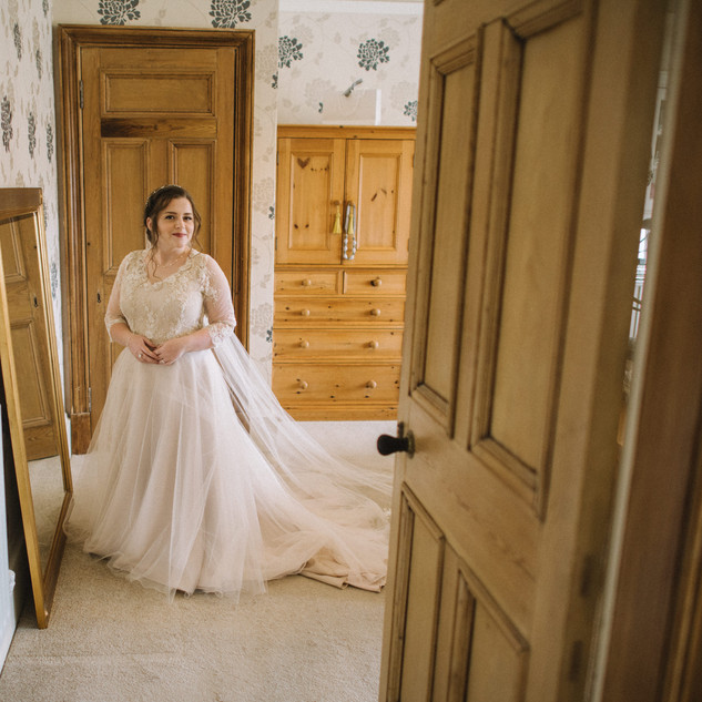 Bespoke Wedding Dress - Soft champagne soft tulle skirt with removable beaded lace bolero.