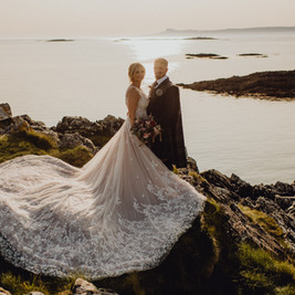 Bespoke Wedding Dress - Starry embroidery with soft dreamy tulle and twinkly glitter layered skirt on a cliff.
