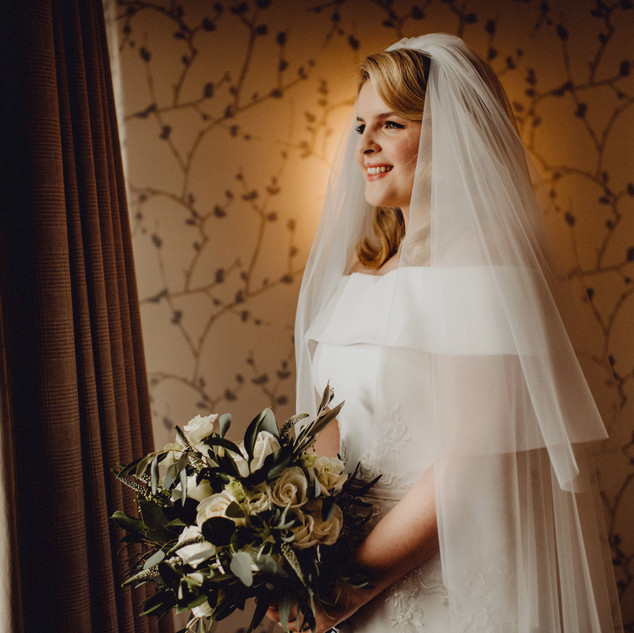 Bespoke Silk crepe bardot bridal gown with embroidered lace appliqué and matching custom design veil.