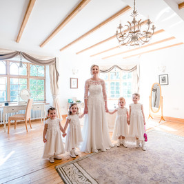 Bespoke Floral Lace and Silk Wedding Gown with matching Flower Girl Gowns.
