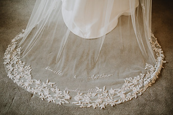 Cathedral length veil with 3D flower lace with rose gold Swarovski. Embroidered personalisation with couples names and wedding date.