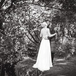 Bespoke Bridal Backless satin gown with embellished straps & silk touch chiffon skirt.