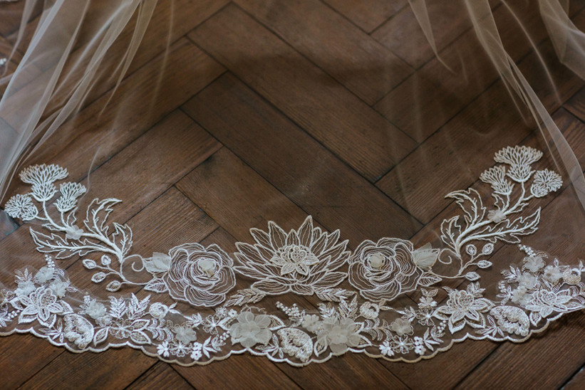 Cathedral length Bespoke Embroidered Veil with lotus flower and thistle design and matching trim.
