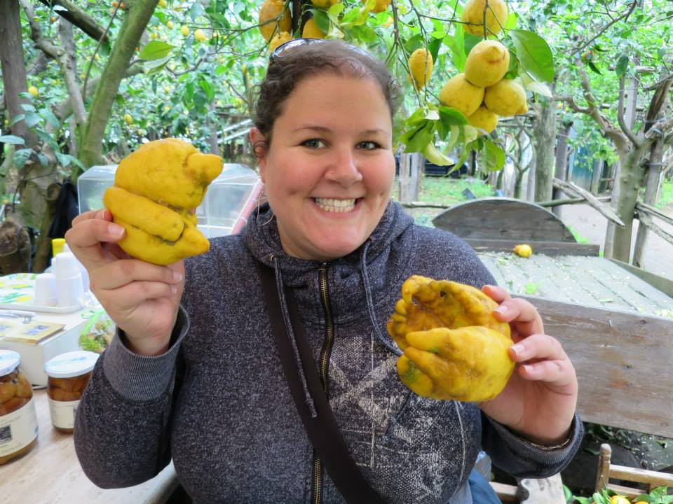 Kathryn enjoying the scent at a lemon grove.