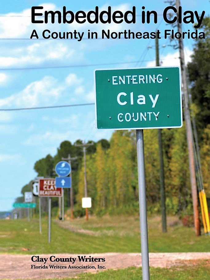 The cover of Embedded in Clay: A County in Northeast Florida depicts a series of signs along a major roadway entering Clay County, Florida.