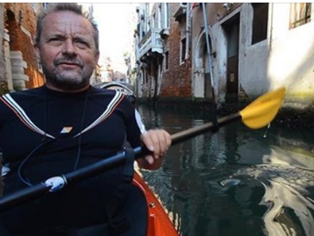 Exploring the beauty of Venice channels with a kayak and a drone