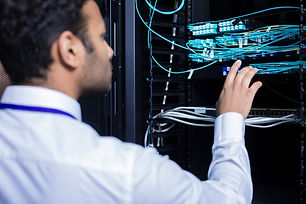 Professional IT administrator checking internet cables.jpg