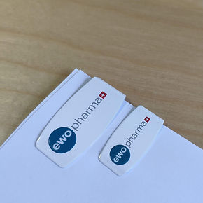 clip EWO Pharma, dutchclip color, clip blanco logo, clip logo EWO Pharma