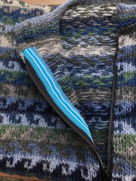 Hunafloi - zip and ribbon facing