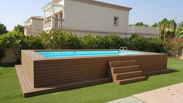 Wooden deck around intex pool