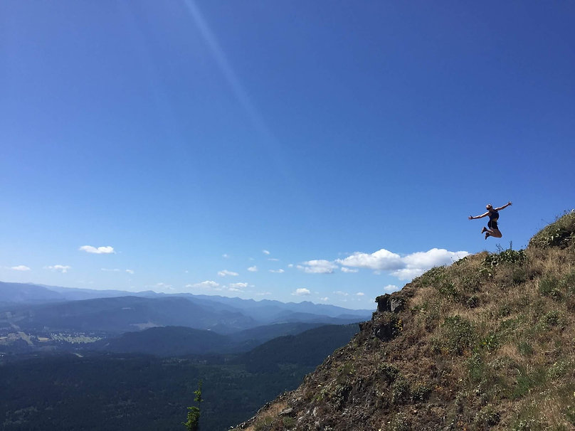 Woman jumping on trail on woman's adventure