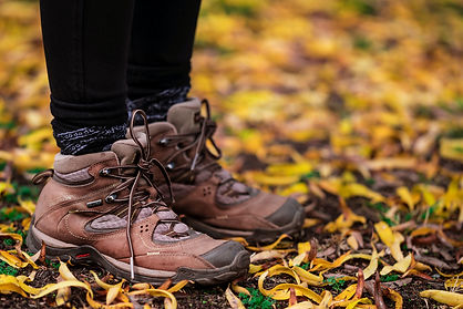 Close-up-of-hiking-boots-crunching-on-trail