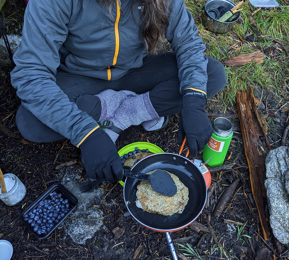 Person-cooking-pancakes-on-backcountry-stove