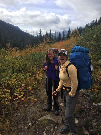 Two-woman-on-backpacking-trip-smiling