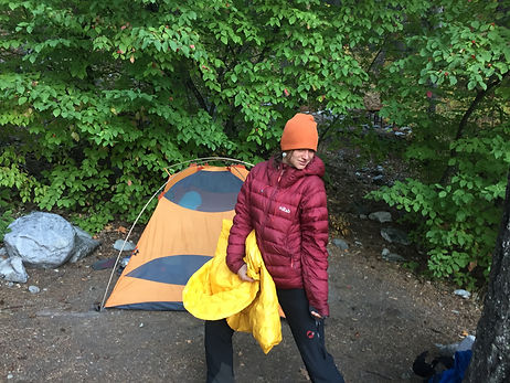 Woman-posing-in-front-of-tent-while-camping