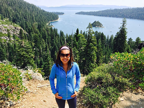 Woman-on-hike-standing-above-lake