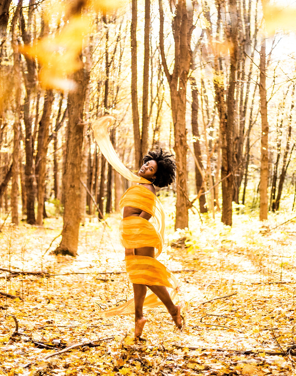 Nude-woman-covered-in-ribbon-in-fall-forest