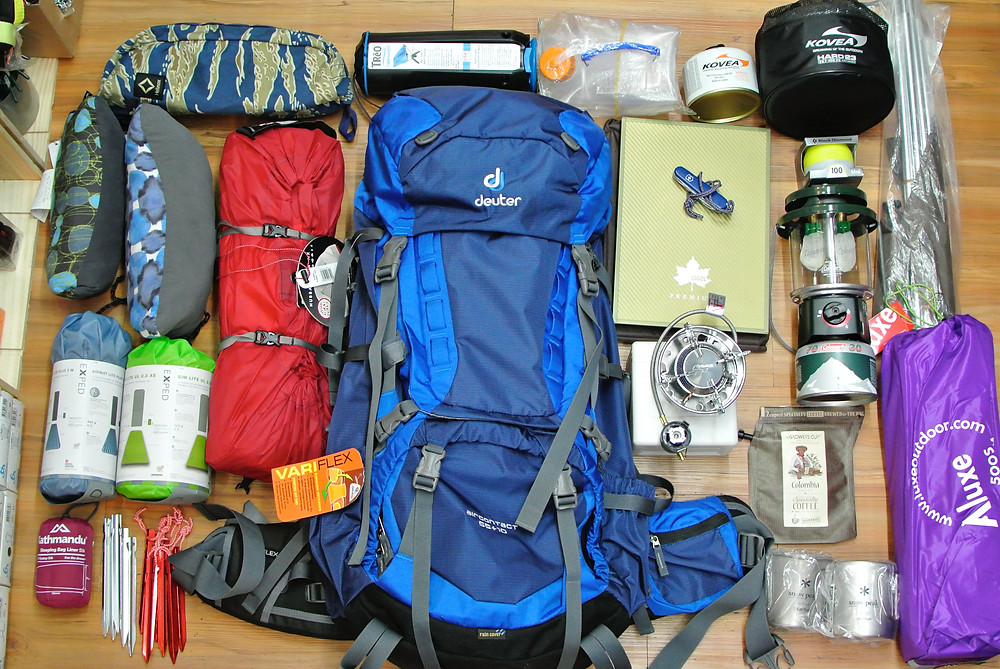 birds-eye-view-of-backpacking-gear-laid-out-on-floor