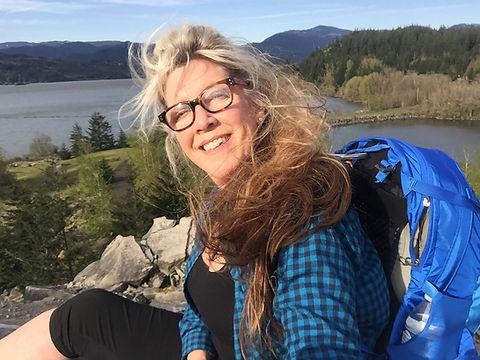 Selfie of woman on backpacking trip