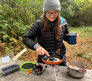 Woman-cooking-pancakes-at-campground