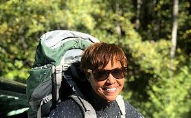 Backpacker smiling on Seattle area women's adventure