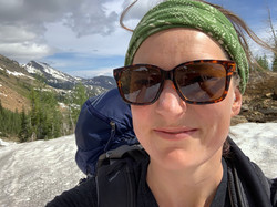 Selfie of woman with snowy mountain background