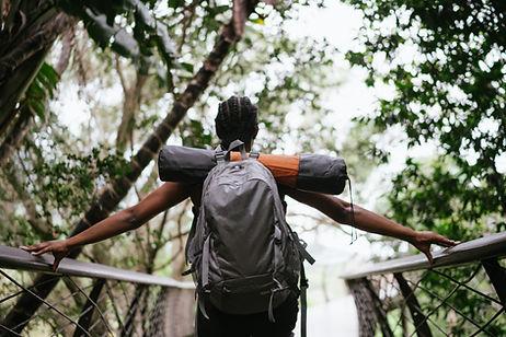 woman-backpacker-walking-over-bridge