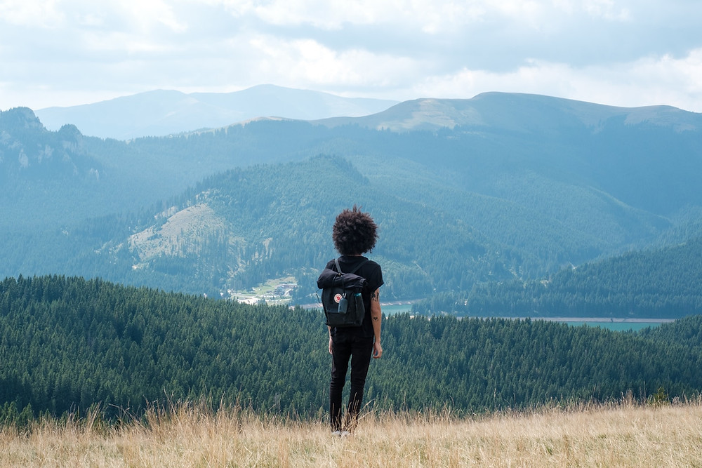 woman-looking-at-mountain-view-on-adventure