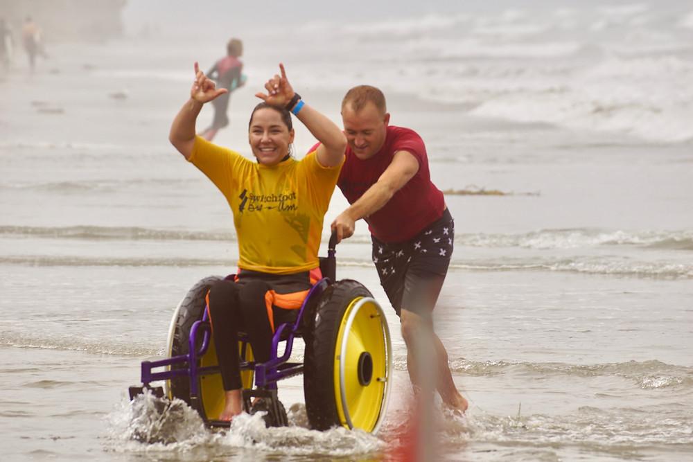 Woman-in-adaptive-wheelchair-on-beach-shore