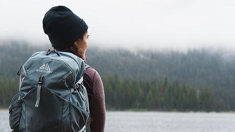 woman-hiker-gazing-at-backcountry-lake
