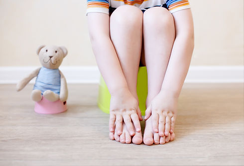 closeup of legs of the child sitting on