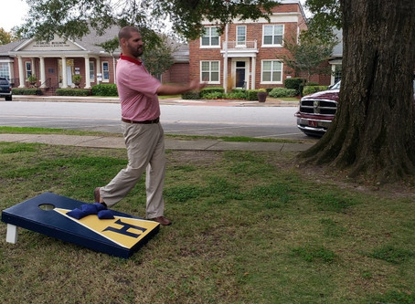 Cindy and Billy Wayne Hamm of Headland Insurance Donate Corn Hole Boards to Square
