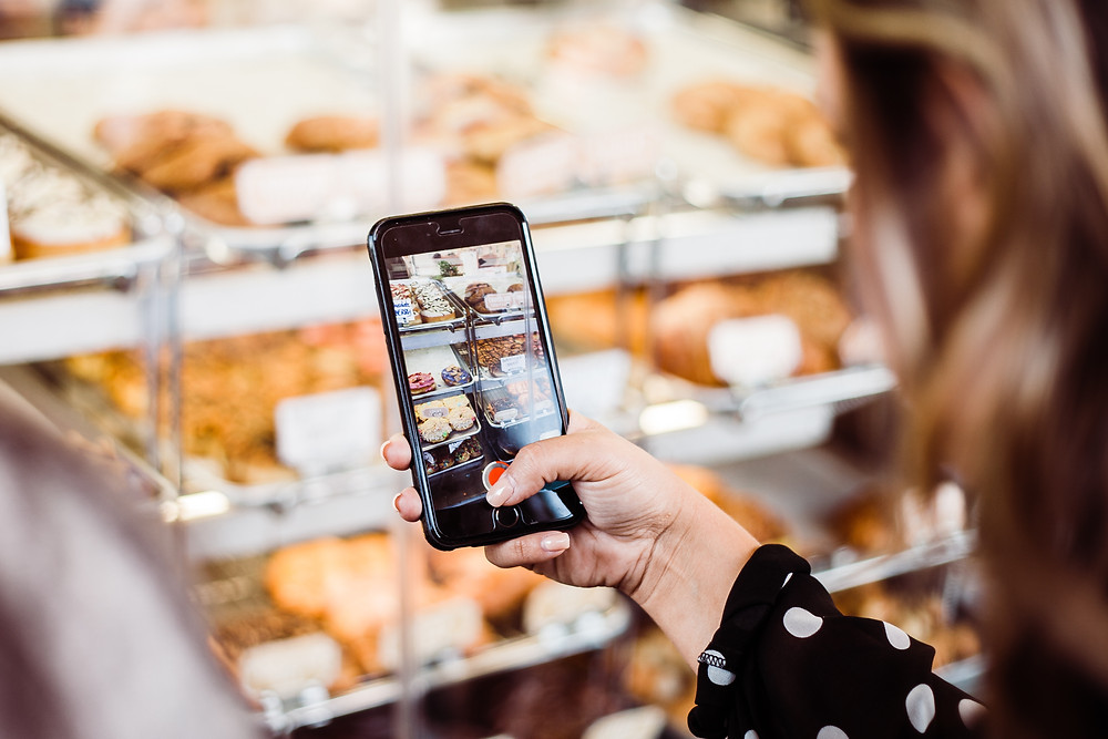 Woman using digital device in grocery store