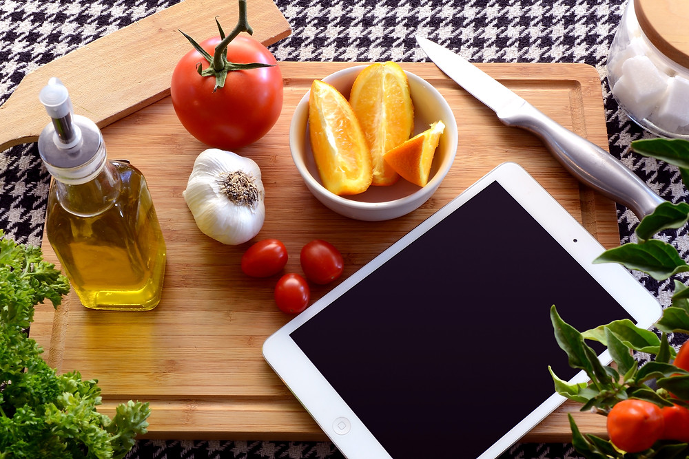 Food ingredients and tablet on table