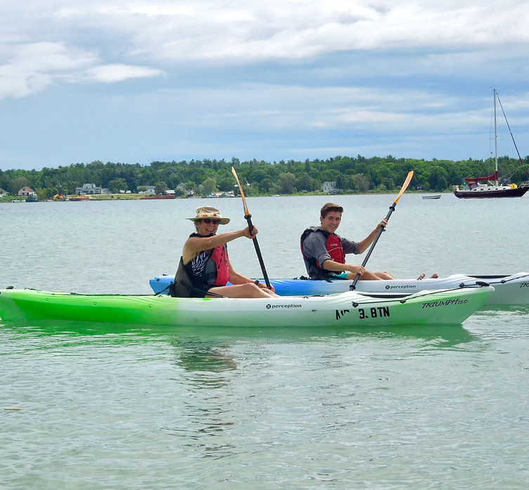 Play Outside Beach House guests enjoy kayaking on Paradise Bay, Beaver Island.