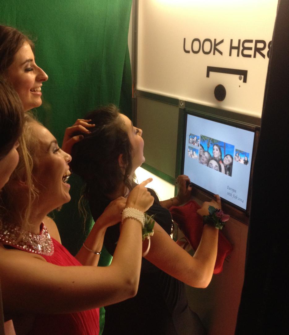 Inside photobooth green screen