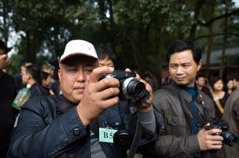 Tourism in China has boomed with the middle classes being able to afford to travel. Tourists compete to get the best photograph