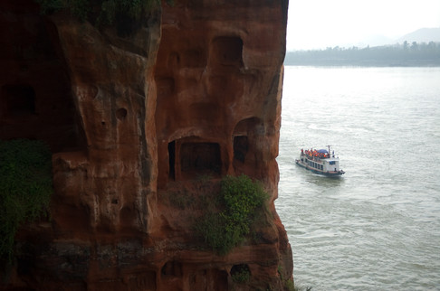 A boat of visitors travelling to the giant Buddha in Leshan
