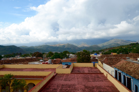A tourist admiring the views alone on a roof in Trinidad