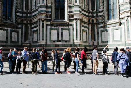 Tourists queue to enter the Duomo di Firenze. At peak season people can wait for over an hour to enter the cathederal
