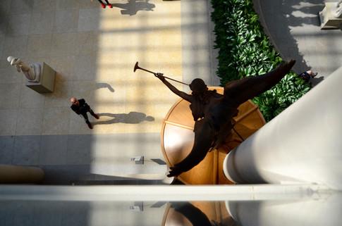 Man gazing at a piece of art at the Metropolitan Museum of Art, NYC