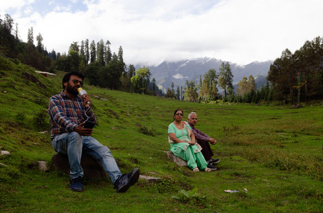 Biking around the Indian himalayas I came apon these Indian tourists with a personal singer to seranade them where they travelled