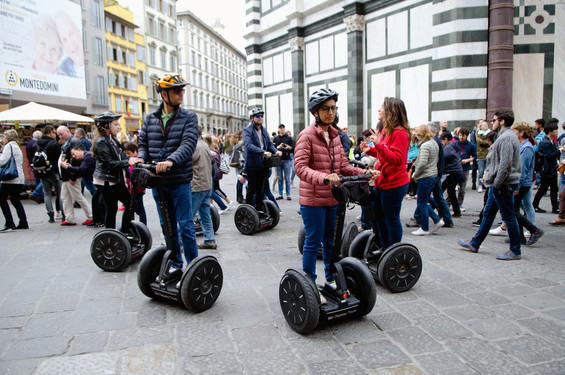 Tourists on a tour around the city of Florence on segways