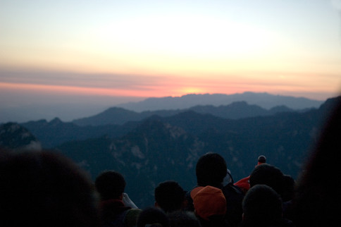 On one of the national holidays in China I climbed Hua Shan, one of the mountains near Xian overnight to get to the top for sunrise. I did this with a few thousand other Chinese people and reaching the top I discovered a large crowd. This is just before the sun came up