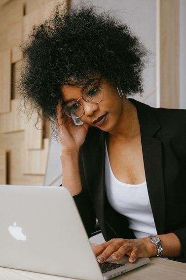 woman-in-black-blazer-wearing-eyeglasses