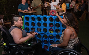 women-playing-connect-four-in-a-bar-3009