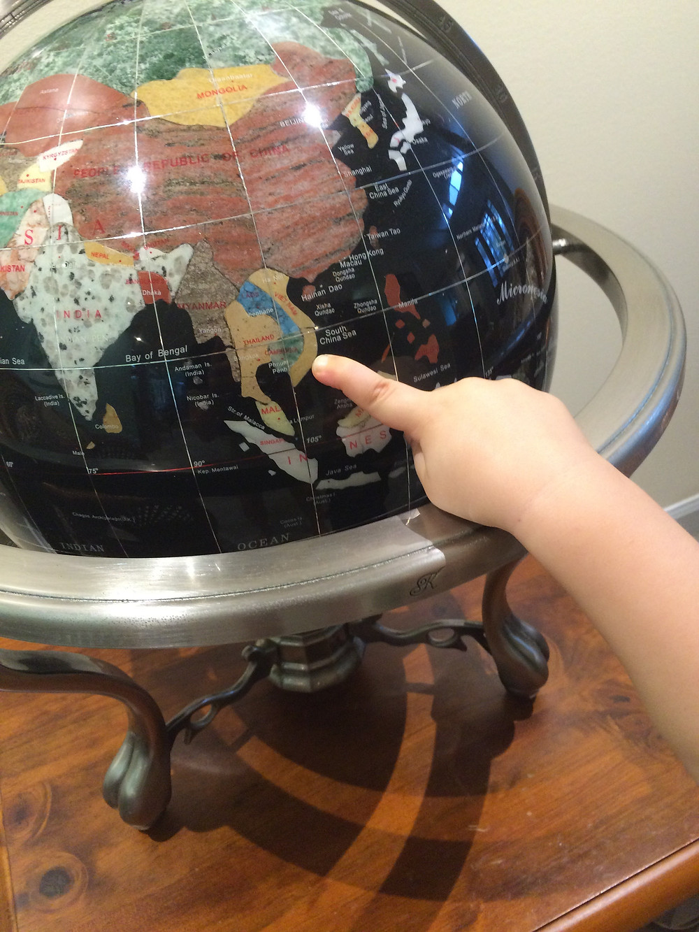 Pointing to Vietnam on the globe