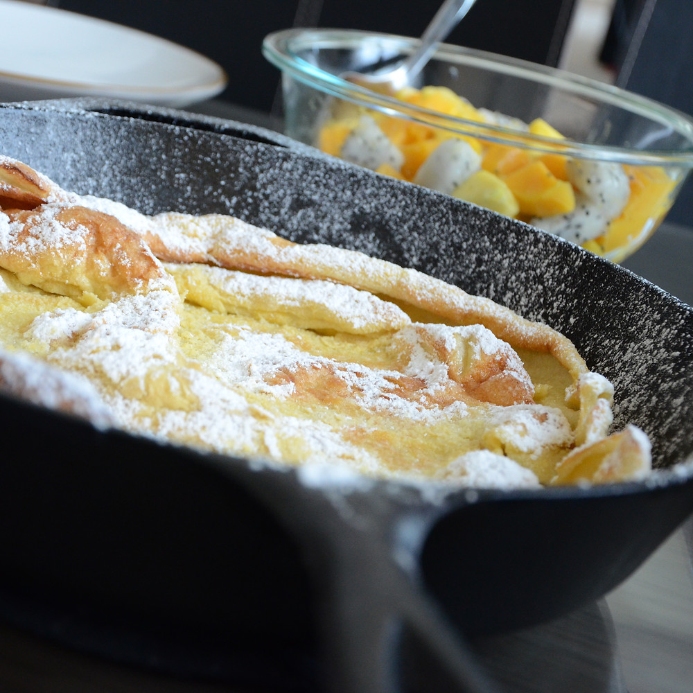 Dutch baby pancake with tropical fruit salad